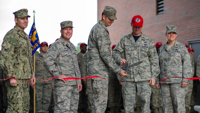 Members from the 560th RED HORSE Squadron, along with joint mission partners and special guests, attend a ribbon cutting ceremony for the opening of a new readiness and training facility Jan. 6, 2017, at Joint Base Charleston, South Carolina. The new buildings will provide dedicated areas for the unit's offices, shops and storage (U.S. Air Force photo by Senior Airman Jonathan Lane).